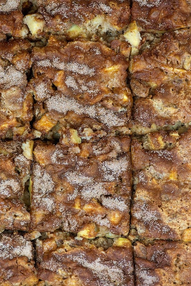 Top down view of apple cake cut into squares.