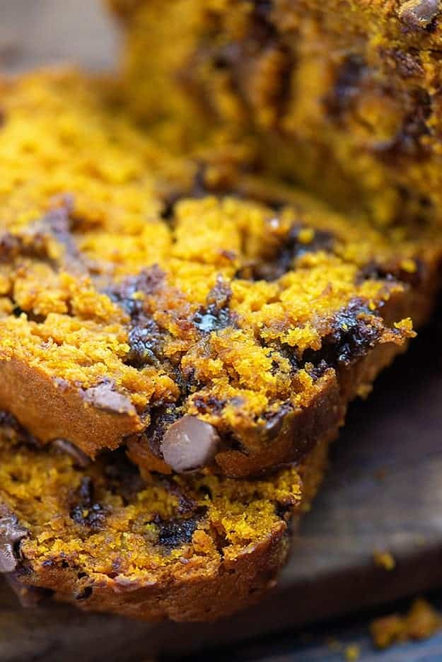 A close up of sliced pumpkin bread falling on top of itself.
