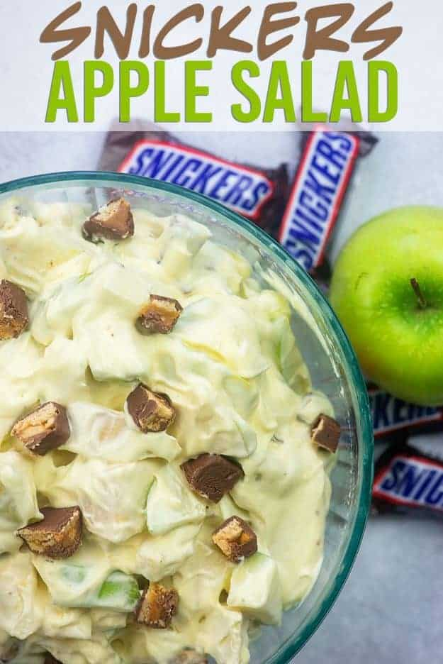 Snickers Apple Salad is a favorite snack, side dish, or dessert at potlucks and get-togethers in the Midwest. We love that creamy dressing! #caramel #apple #fall #recipe