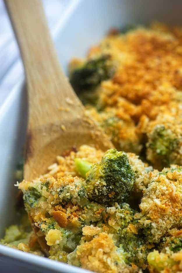 Broccoli on a wooden spoon.
