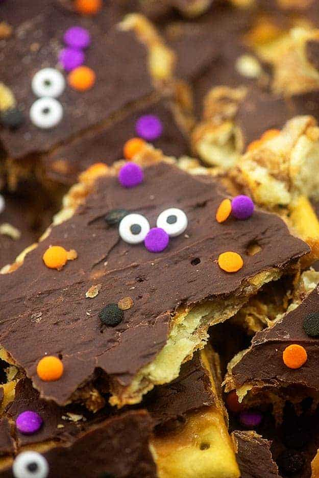 Toffee topped with melted chocolate with a candy face on it.