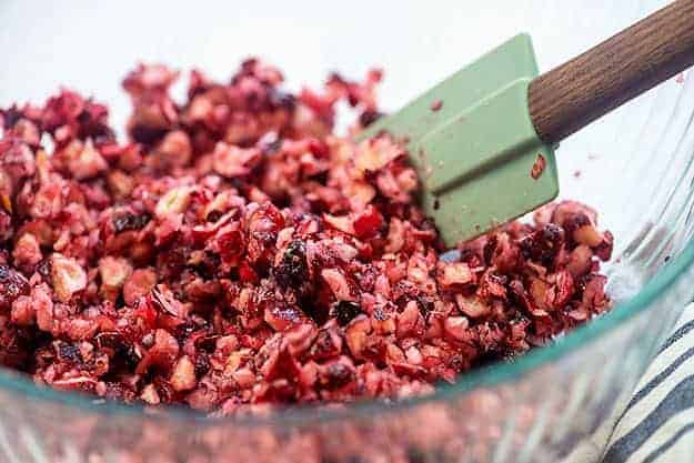 chopped cranberries with sugar in bowl