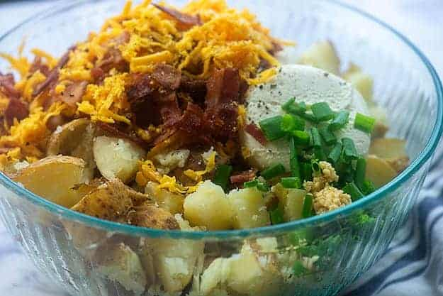 ingredients for twiced baked potato casserole in glass bowl