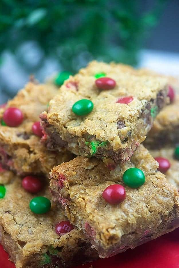 Stacked up squares of cookie bars with M&M\'s in them.