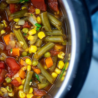 A bunch of vegetables in an instant pot.