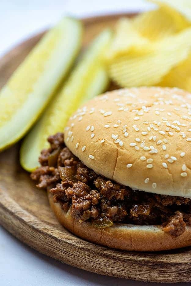 slow cooker sloppy joe meat on bun with pickles