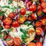 baked bruschetta chicken in white dish