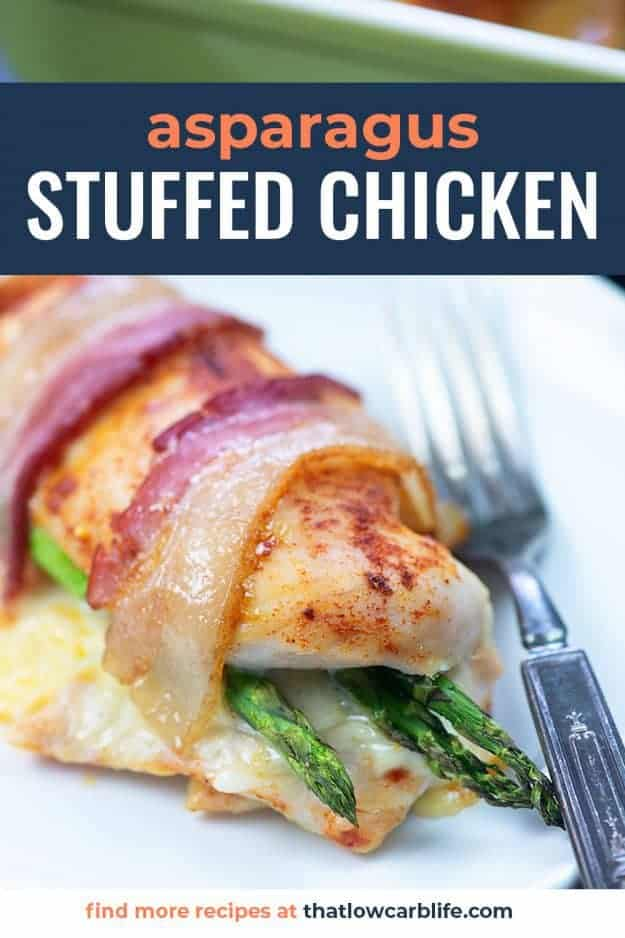 bacon wrapped chicken with asparagus on white plate