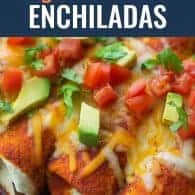 enchiladas in flour tortillas with tomatoes and avocado on top
