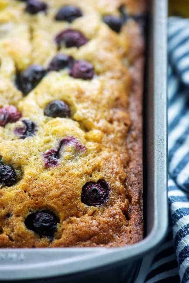 banana bread with blueberries in metal loaf pan