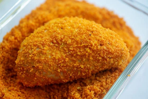 taco pocket coated in doritos crumbs in glass dish