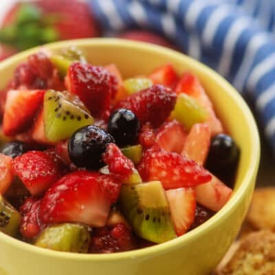 fruit salsa in yellow bowl with cinnamon sugar chips
