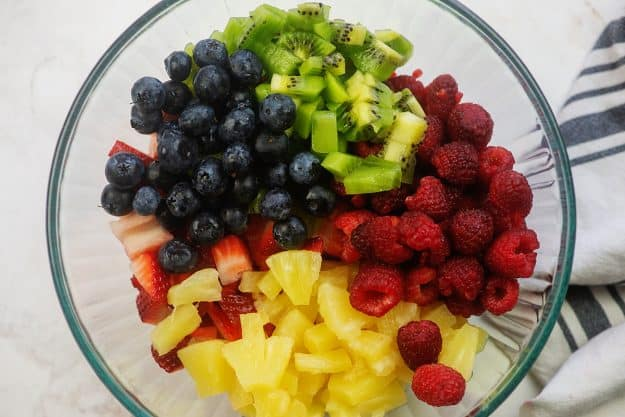 variety of fruit in glass mixing bowl