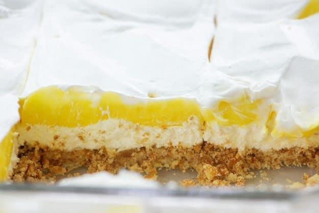 lemon lush dessert in glass pan