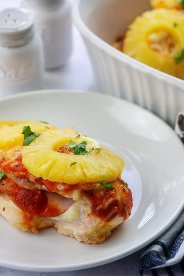 pineapple pizza stuffed chicken on white plate