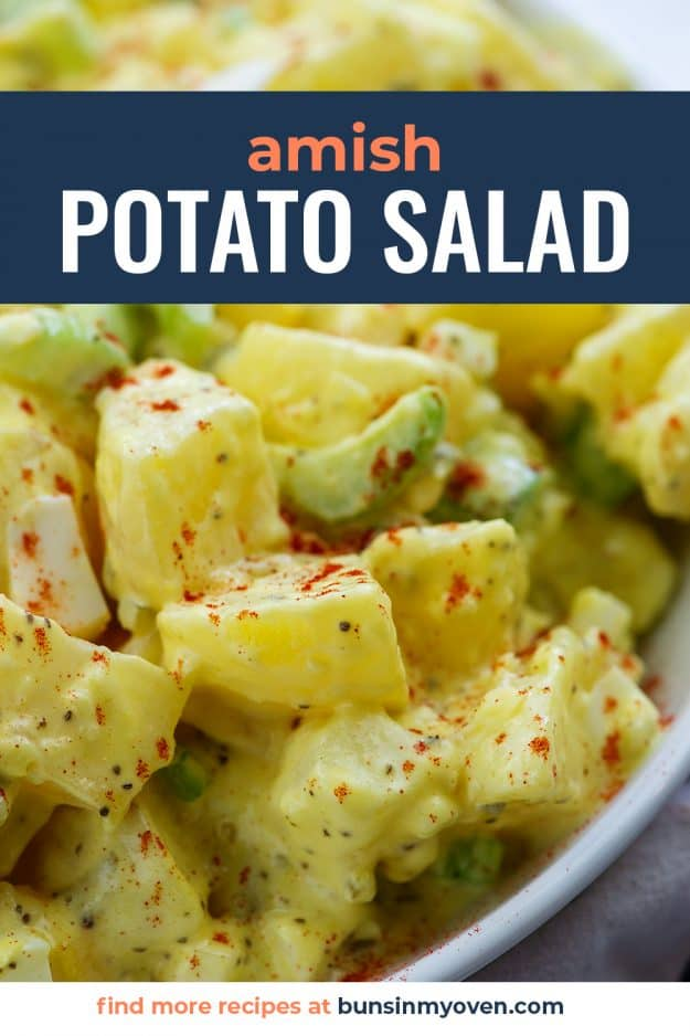 amish potato salad recipe with paprika on top in white bowl