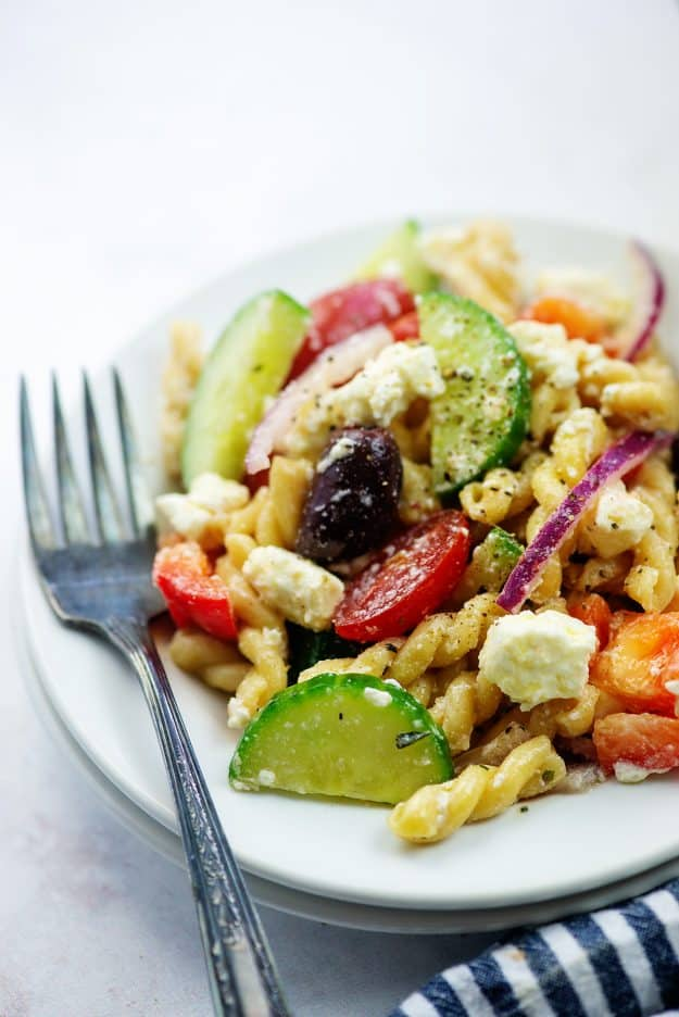 Greek pasta salad recipe on plate with vintage fork