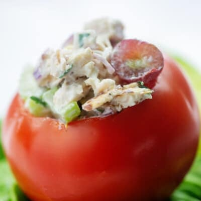 chicken salad recipe stuffed inside a tomato