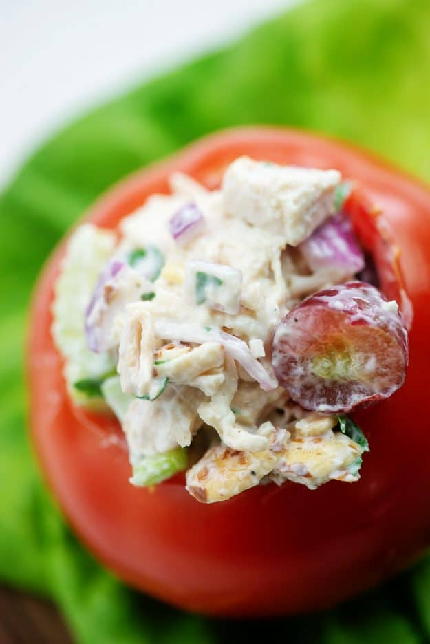 chicken salad with grapes stuffed inside a tomato