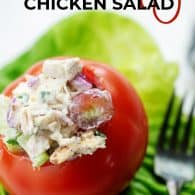 chicken salad in tomato on bed of lettuce
