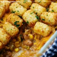 beans and beef in baking dish with tater tots on top