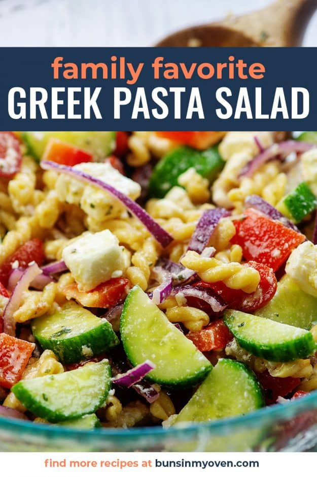 cucumbers, feta, tomatoes, and pasta in glass mixing bowl
