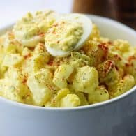deviled egg potato salad in white bowl