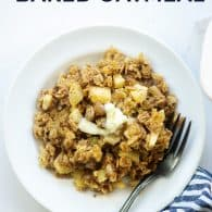 apple cinnamon oatmeal on white plate with vintage fork