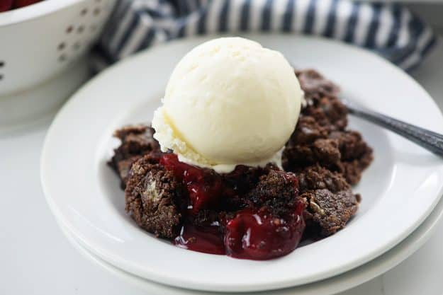 chocolate dump cake with vanilla ice cream on top