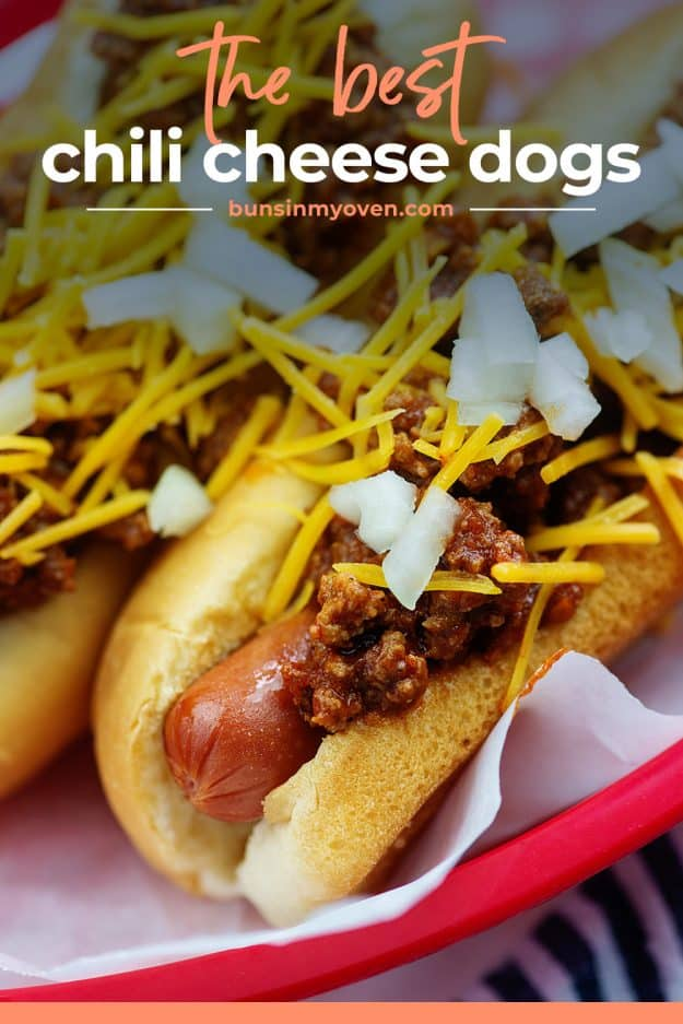 chili cheese dogs in red basket with onions on top