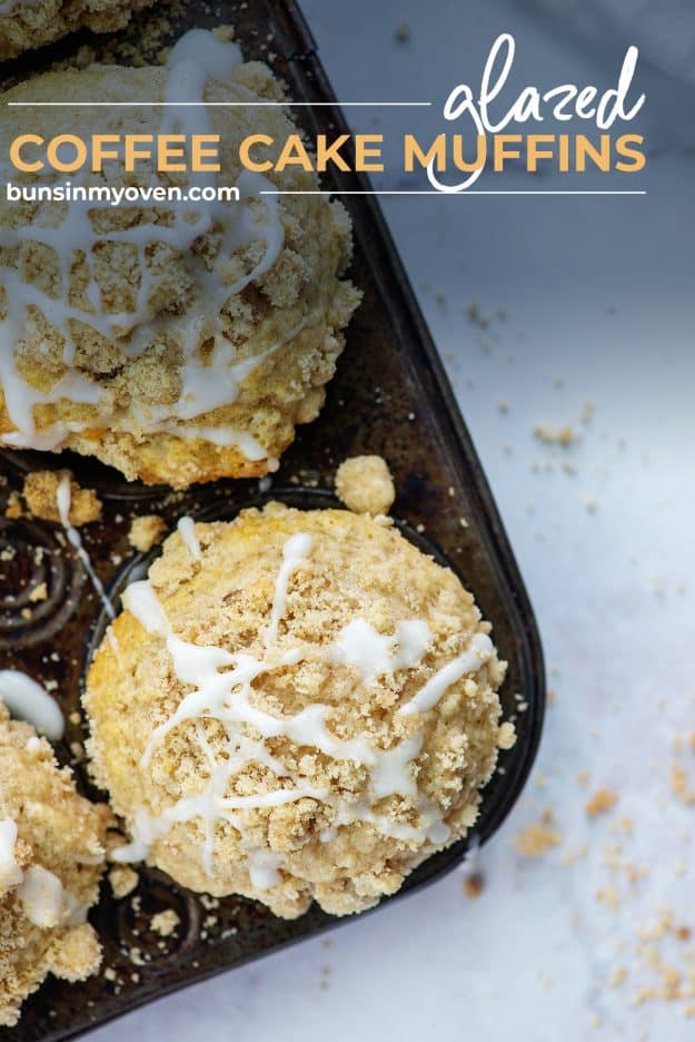 glazed streusel topped muffins in metal muffin tin