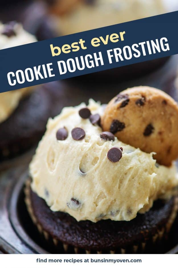 cookie dough frosting with chocolate chip cookie on cupcake in metal pan