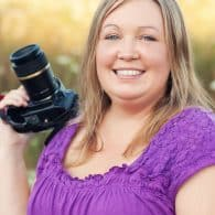 karly campbell holding a camera in a field