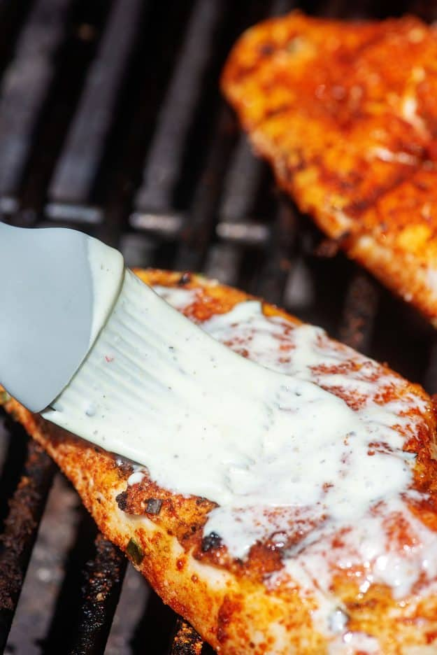 white sauce brushed on chicken breasts.