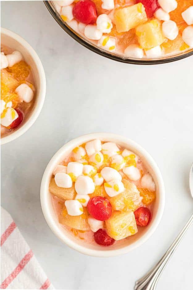 marshmallow fruit salad in small white bowls