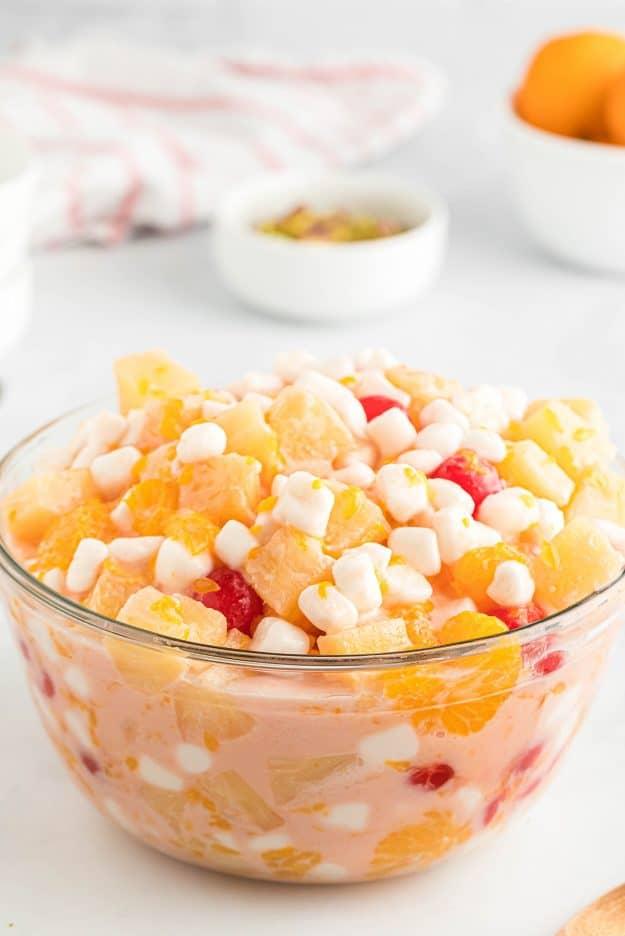 ambrosia in glass bowl with mini marshmallows on top