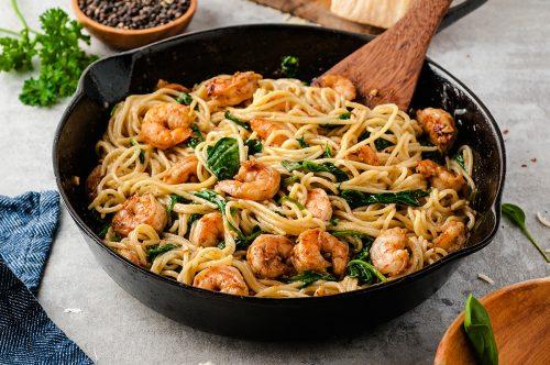 shrimp pasta in cast iron skillet