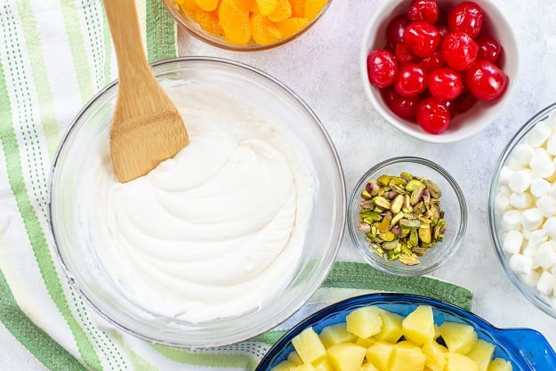 ingredients for ambrosia salad on white counter