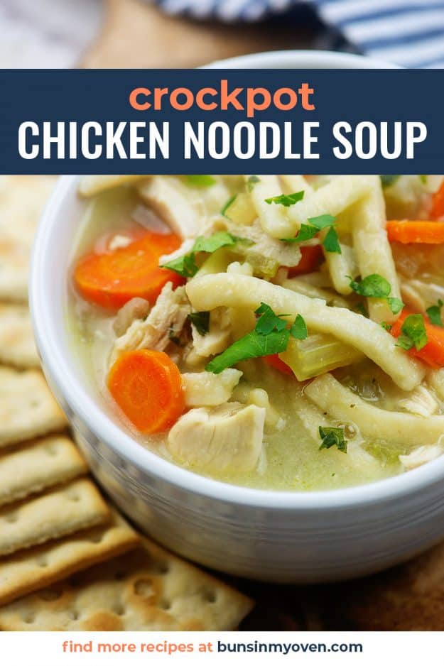 crockpot chicken noodle soup recipe in white bowl with crackers