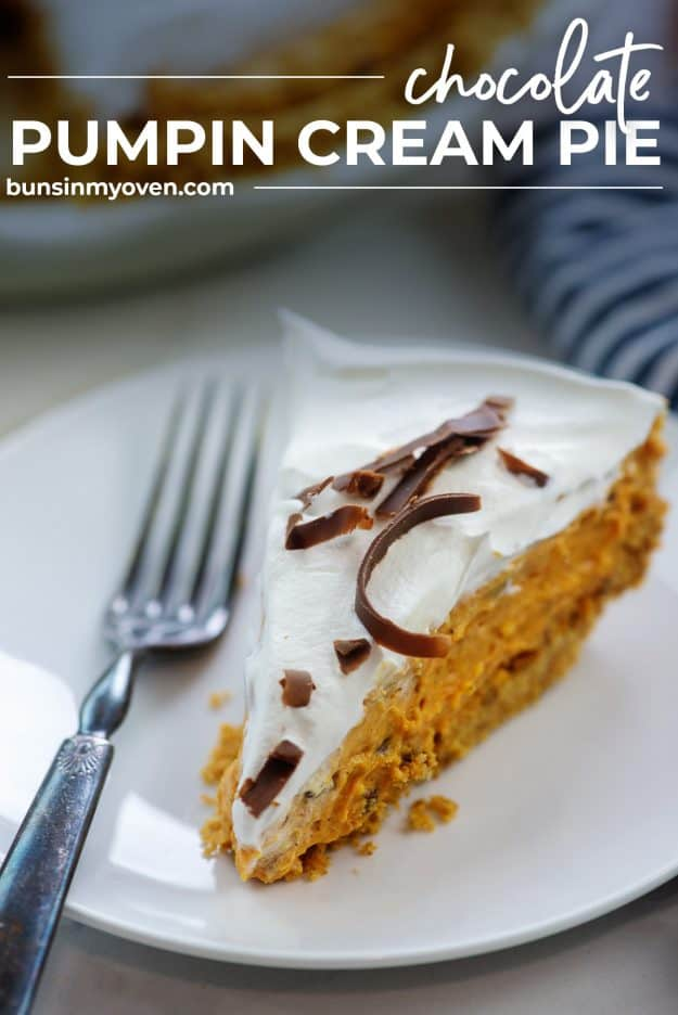 pumpkin pie slice on white plate topped with chocolate