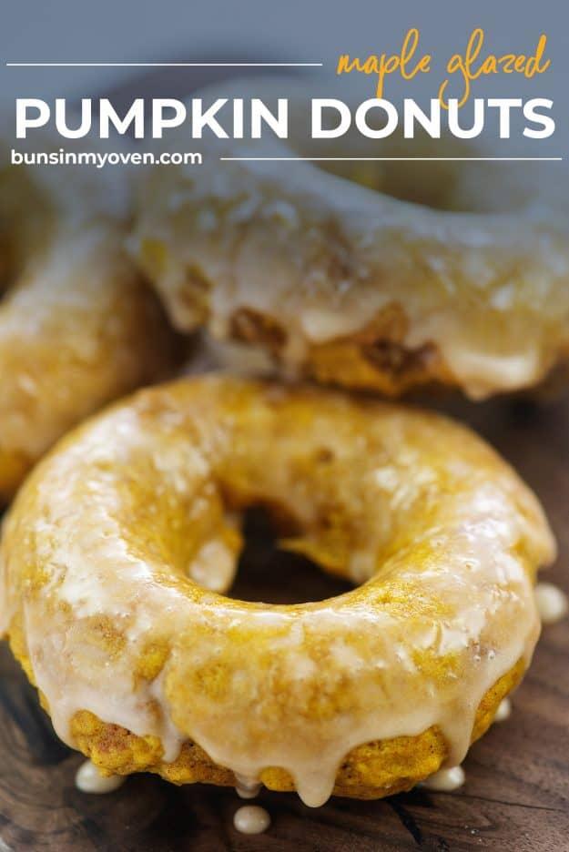 pumpkin donuts on wooden cutting board topped in glaze