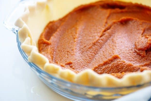 layer of pumpkin filling in pie crust