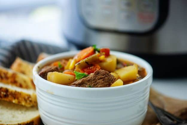 white bowl filled with vegetable beef soup recipe.