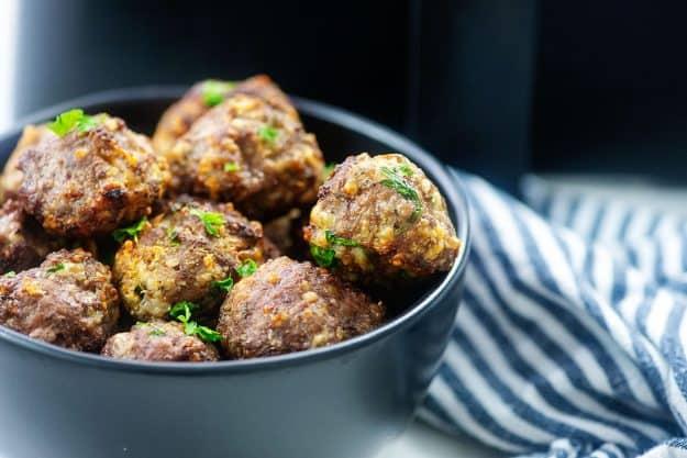 black bowl full of Italian meatballs.
