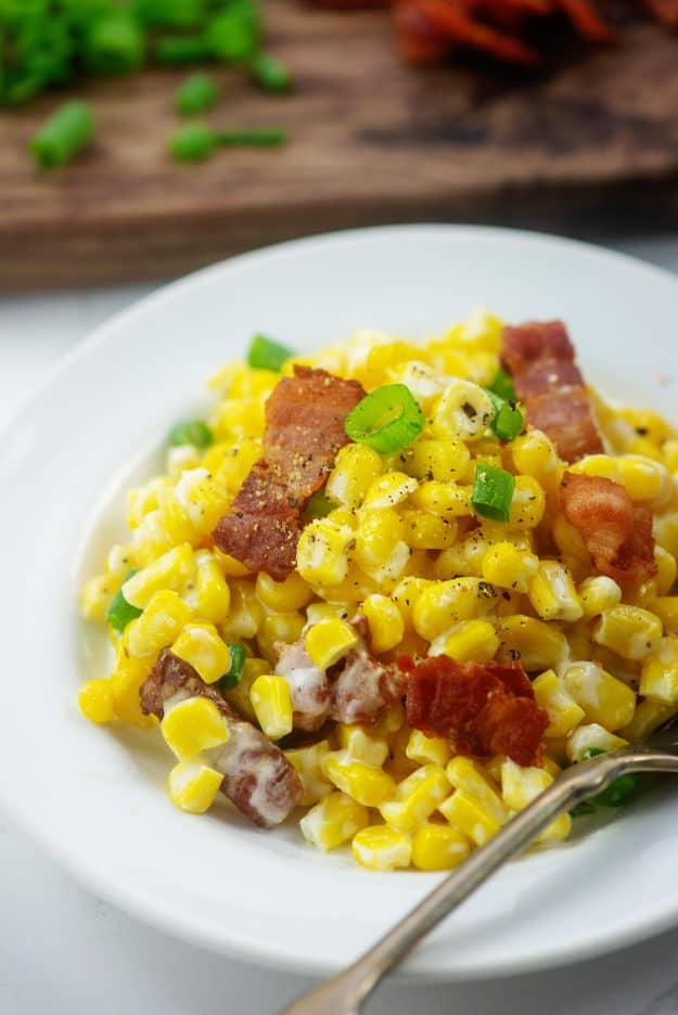 plateful of cream cheese corn with bacon.