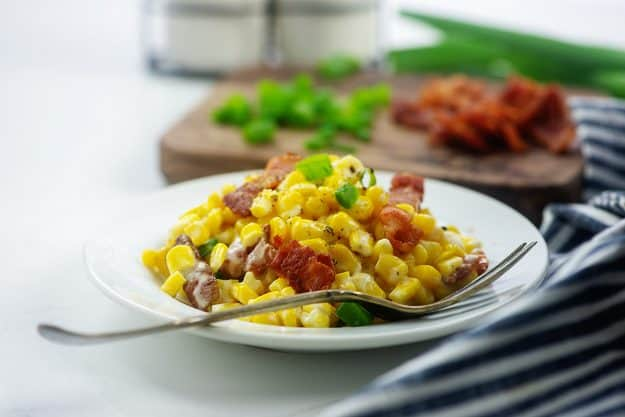 creamed corn on white plate.