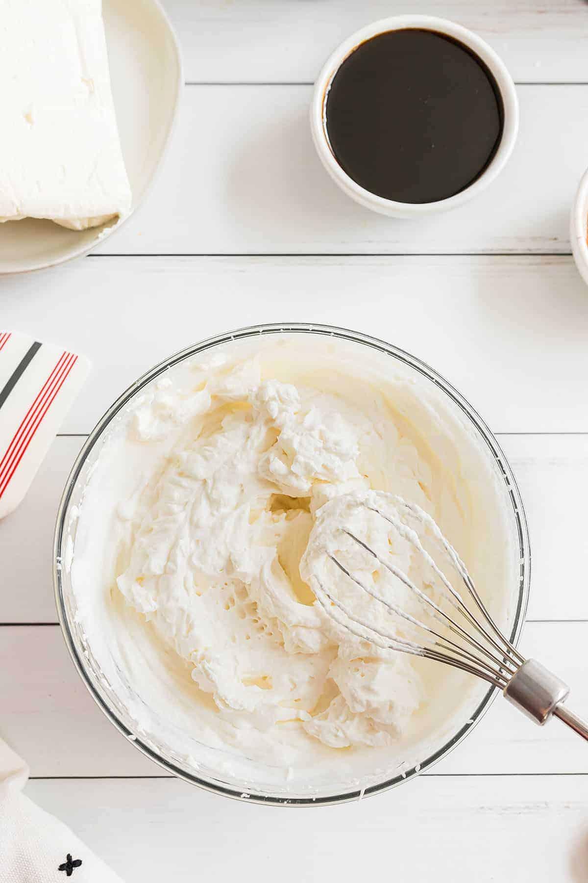 glass bowl full of whipped cream.
