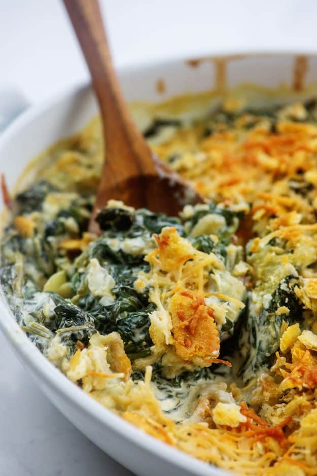 white baking dish full of spinach casserole.