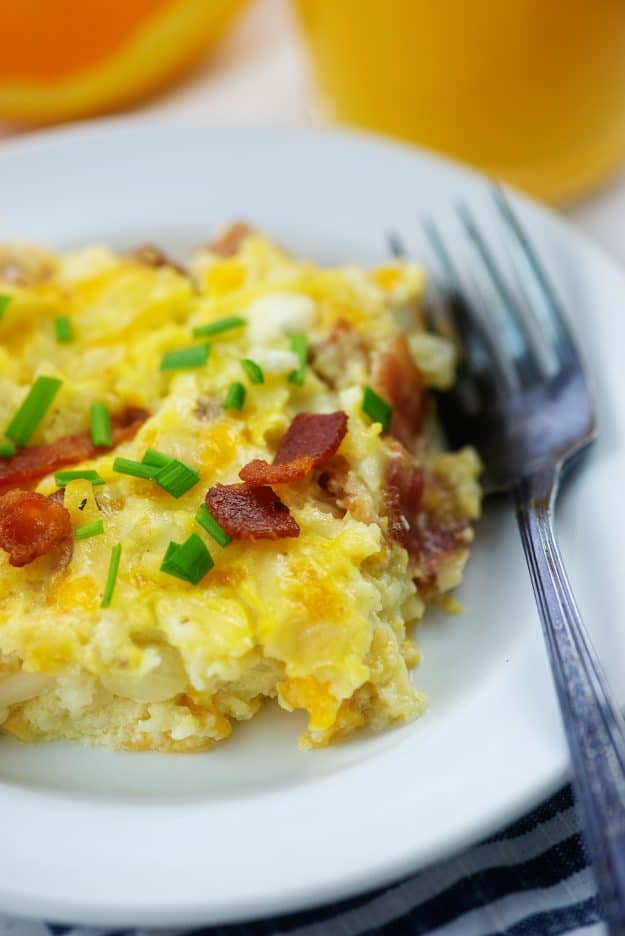 slice of Amish breakfast casserole  on white plate with fork.