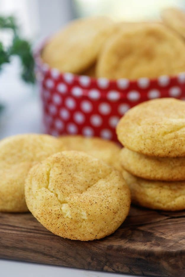 thick and chewy cookies on wooden cutting board.